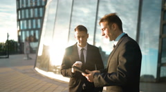 Two businessmen trading outdoor Stock Footage
