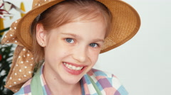 Extreme close-up portrait child girl in hat sitting and drawing butterfly Stock Footage