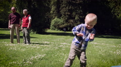 Boy playing frisbee in park Stock Footage
