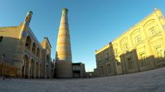 Ancient minaret on the street of the old city. Uzbekistan. Khiva - stock footage