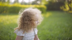 Curly girl in a summer Park jumps Stock Footage