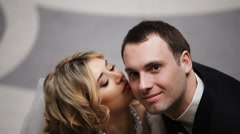 Bride and groom kissing in a stylish interior Stock Footage