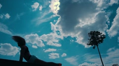 young athletic woman doing yoga in the Park on the sky background - stock footage