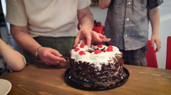 Woman serving cake to children on the table Stock Footage