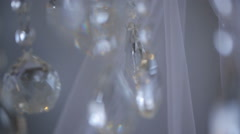 Shiny drops of sparkling crystals hang in air in white room Stock Footage