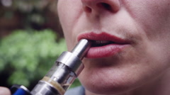 Woman vaping electronic cigarette Stock Footage