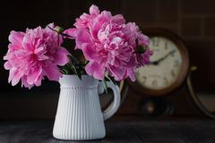 Beautiful pink peony flowers bouquet in vase Stock Photos