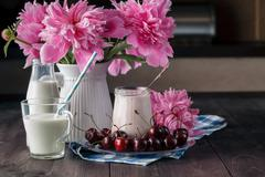 Homemade cherry yogurt in the glass cups on table Stock Photos