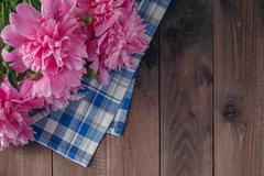 Floral frame with pink peonies on wooden background - stock photo