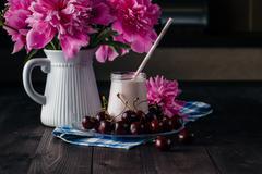 Homemade cherry yogurt in the glass cups - stock photo