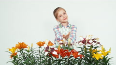 Flower-girl child selling flowers and waving hand and smiling at camera on white - stock footage
