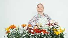 Flower-girl child smiling with teeth at camera on white background. Thumb up. Ok Stock Footage