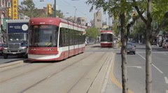 Streetcars and automobiles in downtown Chinatown. Toronto Canada. 4K UHD. Stock Footage