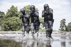 Spec ops police officers SWAT in the water Stock Photos