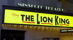 The Minskoff Theater with Disney The Lion King pan shot 4k Stock Footage