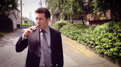 Man vaping electronic cigarette in street Stock Footage
