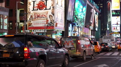 Busy city traffic going through Times Square at night 4k Stock Footage