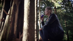 Woman vaping electronic cigarette in forest Stock Footage