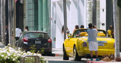 Tourists explore Rodeo Drive and traffic in Beverly Hills, Los Angeles 4K RAW, Stock Footage