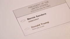 Hand casting a ballot paper to Bernie Sanders Stock Footage