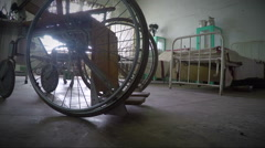 Abandoned wheelchair in old hospital in alcatraz - stock footage
