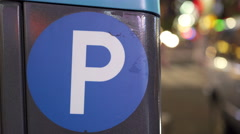 Parking sign at night in busy city 4k Stock Footage