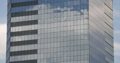 The clouds reflected in glass skyscraper Stock Footage