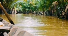Sailing down Mekong Delta Vietnam, oar paddle POV Stock Footage