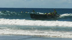 Close up surf boat race finishing a race on the sunshine coast Stock Footage