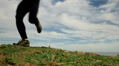 HD young sport man running towards camera in off road trail countryside track Stock Footage