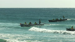 Wide angle view of several surf boats finishing a race Stock Footage