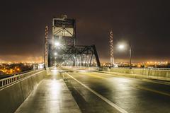 Industrial bridge over Puget Sound at night, Tacoma, Washington State, USA Stock Photos