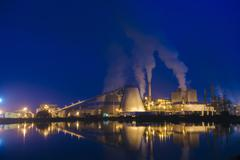 View of pulp mill on waterfront at night, Strait of Juan de Fuca, Port Angeles, - stock photo