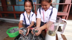 Children make paper mache at Elementary School. Bangkok Thailand Stock Footage