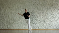Young hip-hop and house female dancer performing against wall in a dancing hall - stock footage