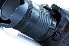 DSLR camera isolated on a white background. - stock photo