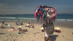 bikini seller at ipanema in rio de janeiro - stock footage