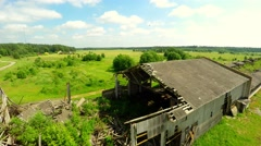 Abandoned old barn house. Broken roof. Low altitude flight. Aerial footage. - stock footage