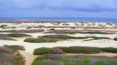 Aerial from sand dunes on Aruba island in the Caribbean Stock Footage