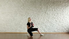 Young attractive girl dancing in the style of house in the dance hall Stock Footage
