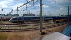Entering Amsterdam central station by train Stock Footage