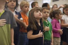 Children reciting Pledge of Allegiance in school Stock Photos