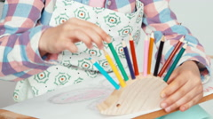 Girl child chooses a pencils for drawing Stock Footage