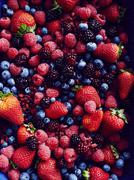 Still life with abundance of strawberries, blackberries, blueberries, - stock photo