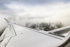 View of clouds and airplane wing above the Pyrenees Stock Photos