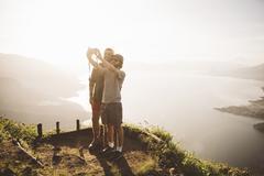 Two young men taking selfie at Lake Atitlan on digital camera, Guatemala - stock photo