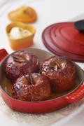 Baked apples in cast iron cookware Stock Photos