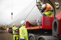 Engineers working on wind turbine - stock photo