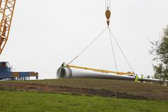 Wind turbine being erected - stock photo