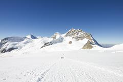 View of tracks in snow covered mountain landscape, Jungfrauchjoch, Grindelwald, Stock Photos